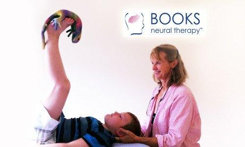 LOGO-PHOTO-16-9.Dr_.-Books-with-Child-ToyTherapy-Playtime, Dyslexia Treatments, ADHD Treatments, Dyslexia Symptoms, Chiropractor, Austin